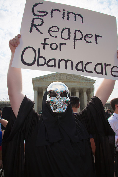 Demonstrators gather in front of the U.S. Supreme Court for their landmark decision on the President's Health Care law on June 28, 2012.