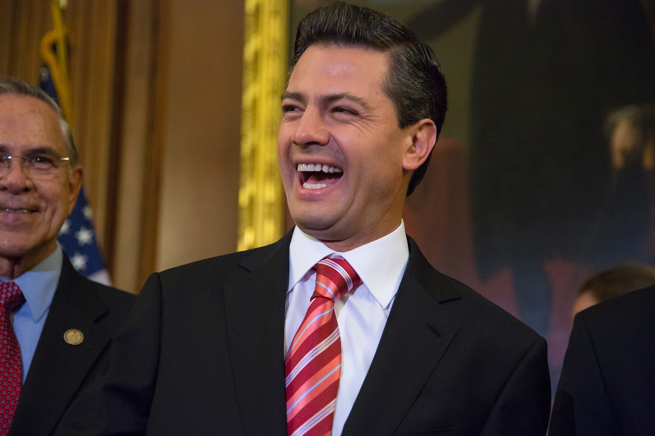 Mexican President-Elect Enrique Pena Nieto smiles after delivering brief remarks in the Rayburn Room at the U.S. Capitol building on November 27, 2012 in Washington, D.C. He appeared there with House Democratic Leader Nancy Pelosi (D-CA) and members of the Congressional Hispanic Caucus. Pena Nieto's July election victory marked the return to power of the former ruling Institutional Revolutionary Party (PRI) after a 12-year absence. He would also visit the White House and meet with President Barack Obama, just a few days before taking office on December 1. (Photo by Jeff Malet)
