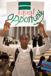 "Damani Taylor (Washington DC) stands in front of the U.S. Supreme Court  building on October 10, 2012 in Washington D.C. Taylor carries sign that reads ""Equal Opportunity"". The Supreme Court was hearing a challenge to its long-standing ruling that race may be considered as a factor in the admissions process (affirmative action). Justices were debating the case of Fisher v. University of Texas. The outcome could have major implications for higher education. (Photo by Jeff Malet)"