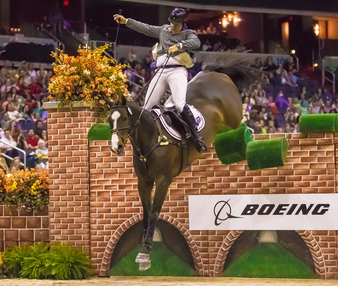 Aaron Vale aboard his horse Wodka L fails to clear the 7 foot wall to take second place in the $25,000 Open Jumper Puissance at the Washington International Horse Show on October 26, 2012. Earlier Belgian rider Olivier Philippaerts and horse Chicago VH Moleneind cleared that height to claim first prize.