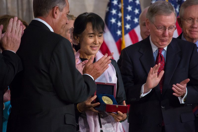 Burma's democracy leader, Nobel Prize winner Aung San Suu Kyi received the Congressional Gold Medal, the highest honor Congress can bestow, at a ceremony Sept. 19, 2012 in the U.S. Capitol Rotunda. Secretary of State Hillary Clinton and former first lady Laura Bush joined congressional leaders to pay tribute to Aung San Suu Kyi, who was first awarded the Congressional Gold Medal in 2008, while she was under 15 years of house arrest in her native country, Burma, also known as Myanmar. Four years after being awarded the medal, Suu Kyi was finally able to accept the honor in person.<br /> <br /> Receiving Congressional Gold Medal from Speaker John Boehner (left). Sen. Mitch McConnell on right.