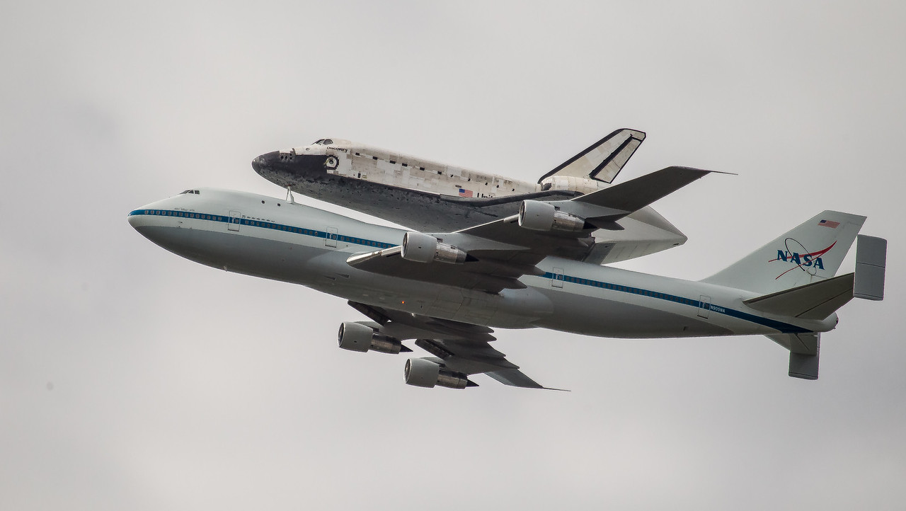 The space shuttle Discovery, attached to a modified NASA 747 aircraft, flies over Washington, D.C., Tuesday, April 17, 2012, as it makes its way to its permanent new home, the Smithsonian's National Air and Space Museum's Steven F. Udvar-Hazy Center in Chantilly, Va. (Photo by Jeff Malet)