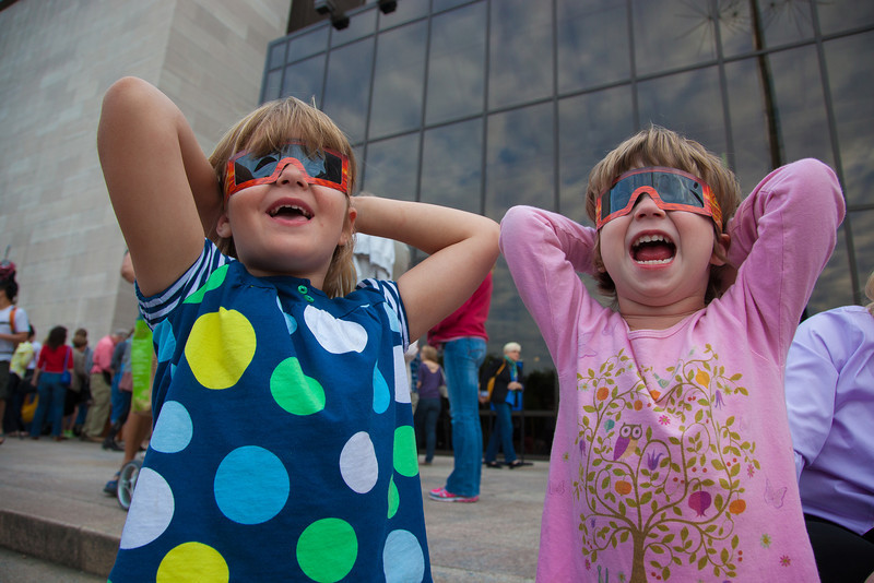 Eleanor Davenport (age 4) and Marianne Cohen (3) try out solar glasses in front of the Smithsonian Air and Space Museum. Hundreds of astronomy enthusiasts, young and old, turned out on on June 5, 2012 to view a rare astronomical event which occurs when the planet Venus passes between the Earth and the Sun. It is something that won't happen again for at least another 100 years.