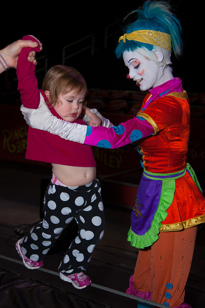 "Kelli the clown teaches helps a youngster walk the ""high""wire.<br /> The Ringling Bros. and Barnum & Bailey Circus presented ""Fully Charged"" at the Verizon Center in Washington DC with shows on March 15-18, 2012."