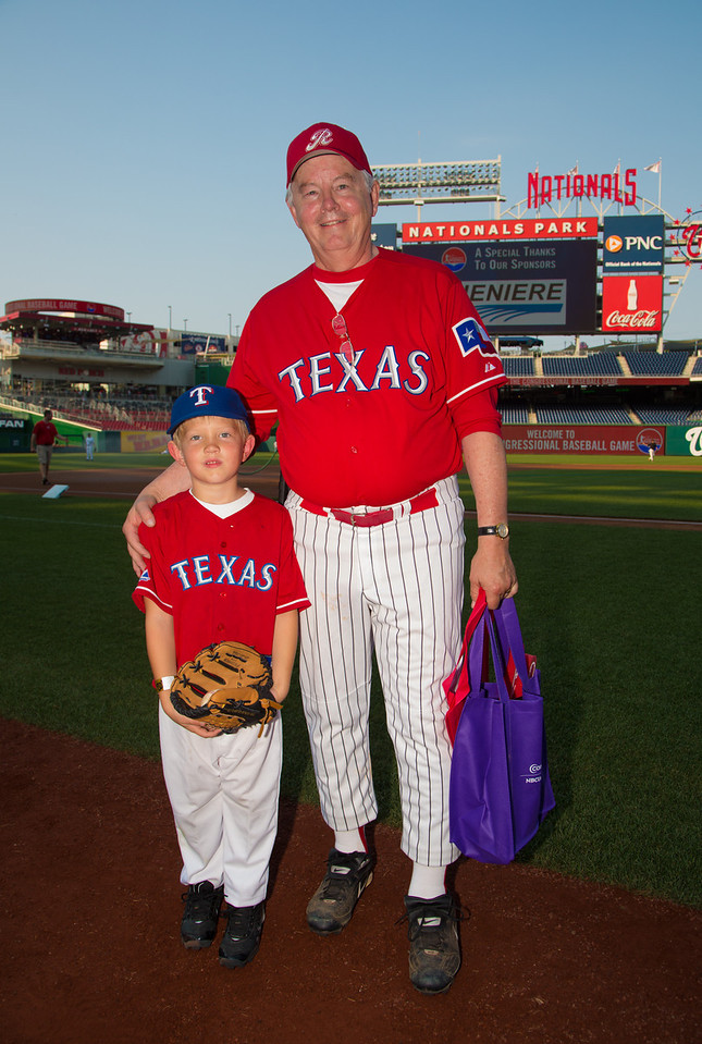 GOP team manager Joe Barton (R-TX) stands with son Jack prior to the annual Congressional Baseball game for charity at Nationals Park. The Democrats beat the Republicans 18-5 on June 28, 2012.