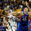 Cory Higgins of Colorado hangs in the air to get a shot over Cole Aldrich of Kansas.<br /> Cliff Grassmick / January 17, 2009