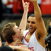 Michael Clark, left, and RJ Demps of Regis Jesuit High School, celebrate winning the 5A Colorado State Basketball Championship on March 15, 2009 in Boulder.<br /> Cliff Grassmick / March 14, 2009