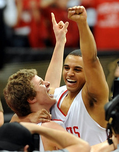 Michael Clark, left, and RJ Demps of Regis Jesuit High School, celebrate winning the 5A Colorado State Basketball Championship on March 15, 2009 in Boulder. Cliff Grassmick / March 14, 2009