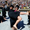 Kristen Jorgensen picks up friend Megan Burns during the celebration of getting their bachelor's degrees.<br /> About 5,280 degrees were conferred Friday  during the 2009 University of Colorado Spring Commencement at Folsom Field.<br /> Cliff Grassmick / May 8, 2009
