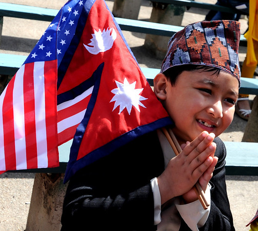 Namaste! from Nirmit Shrestha, 8, while holding flags from the U.S. and Nepal.<br /> Local Nepalese celebrated the Nepal New Year of 2066 with a parade around downtown Boulder, Japanese drums on the Pearl Street Mall, and  with food and a cultural program in Boulder.<br /> Cliff Grassmick / April 19, 2009