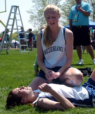 Kelley Robinson comforts her sister Kat after Kat was injured in the 1600m. Kelley won, Kat was third.<br /> Cliff Grassmick / May 16, 2009
