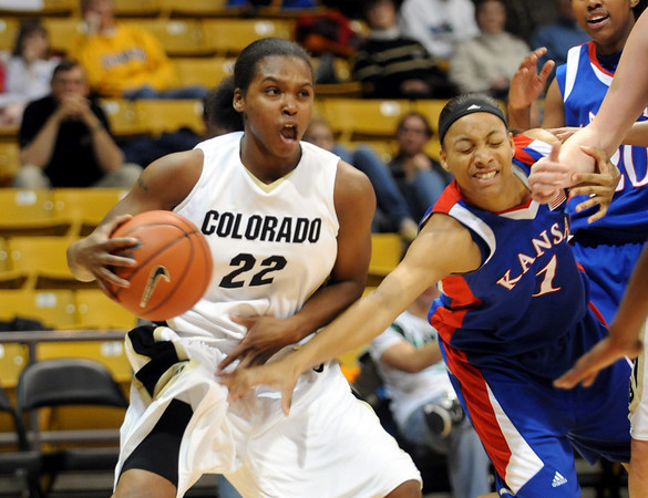 Brittany  Spears of Colorado drives past Aishah Sutherland of Kansas, during the first half of the February 18, 2009 game in Boulder.<br /> Cliff Grassmick / February 18, 2009