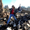 Lydney Nichol, left,  and Bobra Goldsmith walk through what is left of Goldsmith's home on Thursday.<br /> Llama Rancher, Bobra Goldsmith, lost her home to one of the wind generated fire, but no people or llamas were injured at the ranch at 7202 45th Street.<br /> Cliff Grassmick/ January 8, 2009