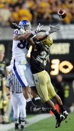 """Jalil Brown of CU breaks up a pass to Dezmon Briscoe of KU.<br /> For more photos of the game, go to  <a href=""""http://www.dailycamera.com"""">http://www.dailycamera.com</a>.<br /> Cliff Grassmick /  October 17, 2009"""