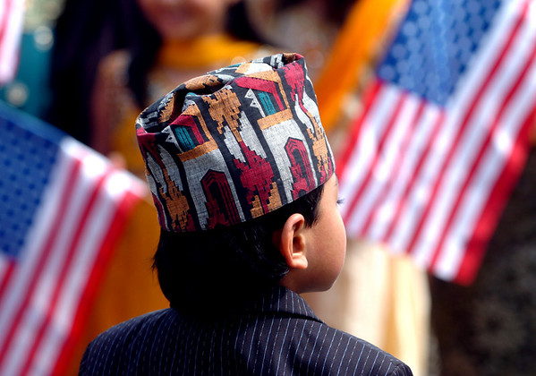 Nadir Shrestha, 7, waits for the parade to begin on Sunday.<br /> Local Nepalese celebrated the Nepal New Year of 2066 with a parade around downtown Boulder, Japanese drums on the Pearl Street Mall, and  with food and a cultural program in Boulder.<br /> Cliff Grassmick / April 19, 2009