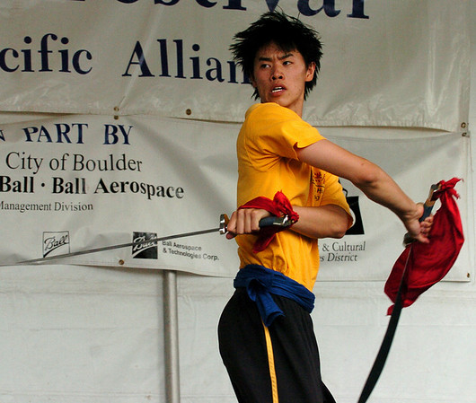 David Wang of Shaolin Hung Mei Kung Fu performs with two swords during a martial arts demonstration.<br /> The 15th Annual Boulder Asian Festival is being held on the Pearl Street Mall and continues at 11 a.m. on Sunday.<br /> Cliff Grassmick / August 15, 2009