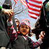 Rishab Karki, 2, proudly waves the U.S. flag to lead the Nepal New Year  parade around  Boulder.<br /> Local Nepalese celebrated the Nepal New Year of 2066 with a parade around downtown Boulder, Japanese drums on the Pearl Street Mall, and  with food and a cultural program in Boulder.<br /> Cliff Grassmick / April 19, 2009