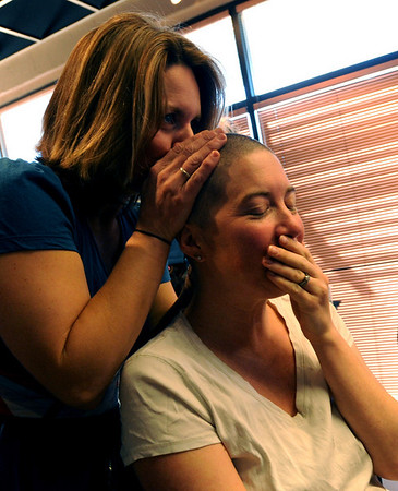 "Dana Bacardi gives Alex Teller a kiss on the head after Alex donated her  hair.<br /> The non-profit group ""There With Care""  that helps critically ill children, hosted the ""Give Hair With Care"" event at Salon Salon in Boulder on Sunday. Dozens of people came in for a haircut and donated their hair to Wigs for Kids.<br /> Cliff Grassmick / March 8, 2009"