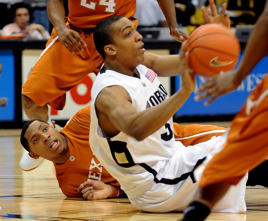 Jermyl Jackson-Wilson, front, of CU gets a loose ball from  Gary Johnson of Texas.<br /> Cliff Grassmick / February 14, 2009