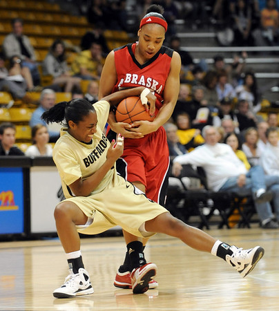 Britney Blythe of Colorado has the ball taken from her by Tay Hester of Nebraska .<br /> Cliff Grassmick / January 31, 2009