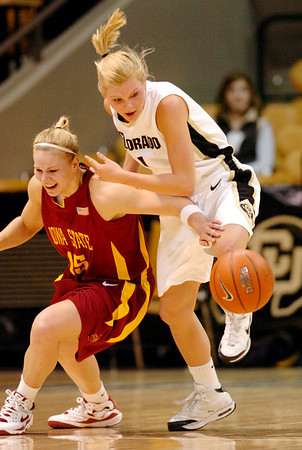 Alyssa Fressle, right, of Colorado knocks the ball away from Heather Ezell of Iowa State during the first half of the February 7, 2009 game in Boulder.<br /> Cliff Grassmick / February 7, 2009