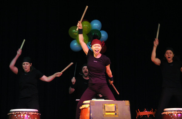Julia Misawa, center, and the rest of Boulder Taiko Hibiki, give a high energy performance during the International Festival.<br /> Performances, food, crafts and information about counties from around the world was available at the 19th Annual International Festival at CU in the Glenn Miller Ballroom on Saturday.<br /> Cliff Grassmick / April 11, 2009