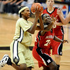 Brittany Spears of Colorado drives past Dominique Kelley of Nebraska late in the game. Spears hit the winning shot to give the Buff the 75-73 win.<br /> Cliff Grassmick / January 31, 2009