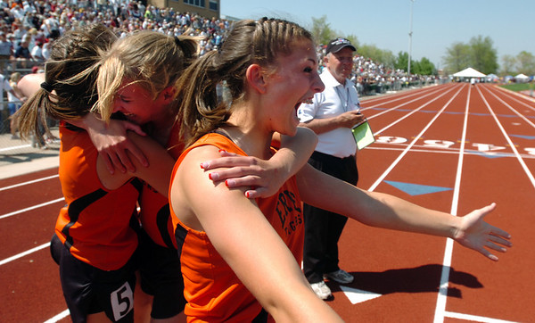 Kerrianne Welch, right, of Erie, celebrates the 3A  4 X 100m relay win at the Colorado State Championships on Saturday.<br /> Cliff Grassmick / May 16, 2009