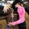 "Kaila DeJane, left, and Erin Parker, both of Mead, show their affection for their horses at the Boulder County Fair in Longmont on Friday.<br /> For a video and photo gallery, go to  <a href=""http://www.dailycamera.com"">http://www.dailycamera.com</a>.<br /> Cliff Grassmick / July 31, 2009"