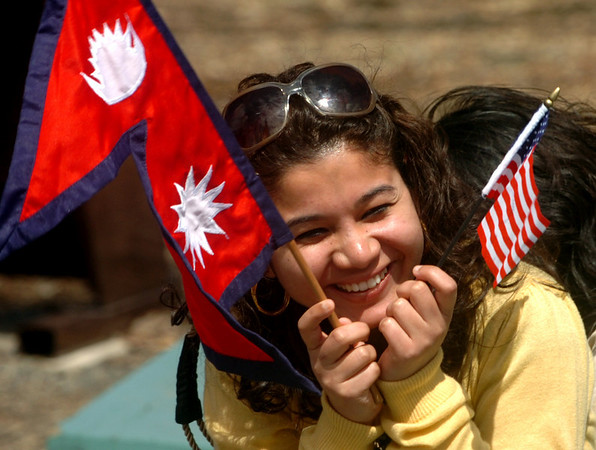 Neeti Acharya poses for a photo  with both the U.S. and the Nepalese flag before the parade.<br /> Local Nepalese celebrated the Nepal New Year of 2066 with a parade around downtown Boulder, Japanese drums on the Pearl Street Mall, and  with food and a cultural program in Boulder.<br /> Cliff Grassmick / April 19, 2009