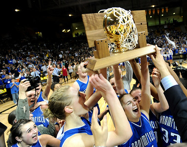 The Broomfield Eagles hold up the 4A State Championship trophy after beating Mullen 49-47. Cliff Grassmick / March 13, 2009