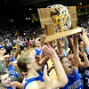 The Broomfield Eagles hold up the 4A State Championship trophy after beating Mullen 49-47.<br /> Cliff Grassmick / March 13, 2009