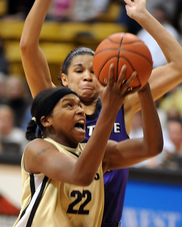 Brittany Spears of Colorado  tries to score on Marlie Gibson of KSU.<br /> Cliff Grassmick / March 7, 2009