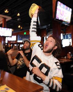 "Matt D'Ella, right, is working the Steelers ""Terrible Towel"" as it appears the steelers scored a touchdown in the first quarter of the Super Bowl. Gavin Levy is on the left. The Lazy Dog Saloon was packed with Super Bowl watchers on Sunday. Cliff Grassmick / February 1, 2009"
