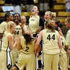 The Colorado team celebrates the 2-point win over Nebraska on Saturday.<br /> Cliff Grassmick / January 31, 2009