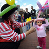 "Marty ""the magic"" Jewell, left, makes a balloon for  Zoey Zacek, 2. Marty was in Boulder to celebrate World Laughing Day.<br /> Sunday, May 3, 2099 was World Laughing Day. About 20 people celebrated the occasion on the Pearl Street Mall.<br /> Cliff Grassmick / May 3, 2009"