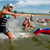 "Matt Reed, left, takes off with the other pro men at the Boulder Peak. He raced and won the day before in Minnesota.<br /> The Boulder Peak Triathlon was held at the Boulder Reservoir on Sunday.<br /> For more photos, check the photo galleries at  <a href=""http://www.dailycamera.com"">http://www.dailycamera.com</a>.<br /> <br /> Cliff Grassmick / July 12, 2009"