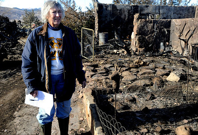 Bobra Goldsmith looks over the  burned out foundation where her home stood yesterday. Llama Rancher, Bobra Goldsmith, lost her home to one of the wind generated fire, but no people or llamas were injured at the ranch at 7202 45th Street. Cliff Grassmick/ January 8, 2009