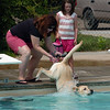 "Linda Myers had to give Oliver the dog a little help getting in the pool.<br /> Dogs and owners were able to have some wet fun during Dog Dayz at Scott Carpenter Pool in Boulder on Sunday.  Dog Dayz will continue through September 7, check  <a href=""http://www.BoulderParks-Rec.org"">http://www.BoulderParks-Rec.org</a> for the  daily schedule. For more photos and a video, go to  <a href=""http://www.dailycamera.com"">http://www.dailycamera.com</a>.<br /> Cliff Grassmick / August 23, 2009"