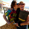 "Fireman Jim Harrison gives Mary Ann Rodak-Friedman a kiss after dropping off a full boot of firework donations.<br /> Mary Ann Rodak-Friedman helped take in donations for the Flash  Fund, named after her late husband, Mark ""Flash"" Friedman, in Nederland on Saturday.<br /> <br /> <br /> Cliff Grassmick / June 27, 2009"