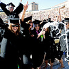 Kristen Jorgensen pops the cork on a bottle of champagne  with her friends during their graduation celebration.<br /> About 5,280 degrees were conferred Friday  during the 2009 University of Colorado Spring Commencement at Folsom Field.<br /> Cliff Grassmick / May 8, 2009