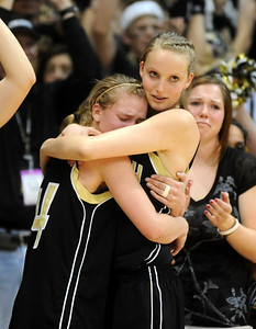 Alex Evans, left and Katie O'Brien of Monarch console each other after the Coyotes loss in the 5A championship game. Cliff Grassmick / March 13, 2009