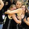 Alex Evans, left and Katie O'Brien of Monarch console each other after the Coyotes loss in the 5A championship game.<br /> Cliff Grassmick / March 13, 2009
