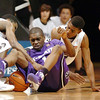 Dwight Thorne, left, and Cory Higgins of CU, attempt to get the ball from Fred Brown of KSU.<br /> Cliff Grassmick / January 24, 2009