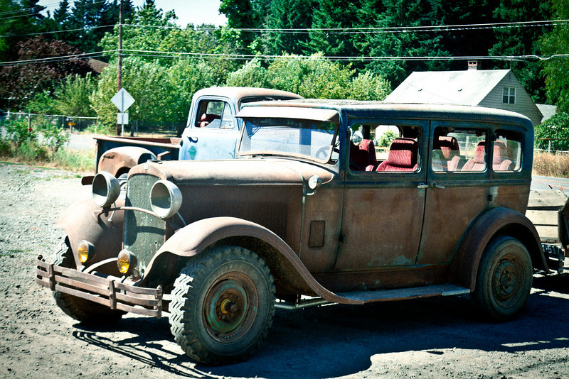 Junky old cars in front of Blueberry Hill Farm