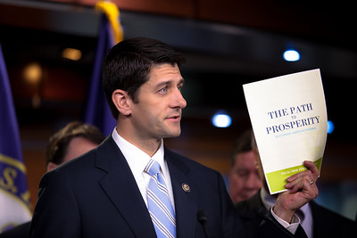 "Rep. Paul Ryan (R-WI), chairman of the House Budget Committee, holds up a copy of the 2012 Republican budget proposal during a news conference on April 5, 2011 on Capitol Hill in Washington, DC. Ryan's plan, which the GOP calls the ""Path to Prosperity"" includes significant changes to Medicare and Medicaid, government subsidized healthcare programs, and would cut $6.2 trillion in government spending over the next 10 years."