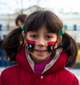 Seven year old Rana, wearing the 1951 first national flag of modern Libya on her cheeks, calls for the ouster of Libyan leader Moammar Gadhafi. Hundreds of demonstrators gathered in front of the White House calling on the United States to do more to help liberate Arab nations. The protestors stood in solidarity with pro-democracy movements taking place in Libya, Yemen, Bahrain, Iraq, Iran and the Sudan. In Washington DC on Saturday, February 26, 2011.