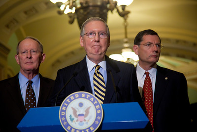 A grim Senate Minority Leader Mitch McConnell (R-KY), speaks with reporters about the impending federal debt crisis on Capitol Hill on July 19,