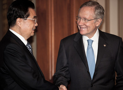 Chinese President Hu Jintao meets with US Senate majority leader Harry Reid, who had earlier called Mr Hu a dictator, on Jan. 20, 2011, on Capitol Hill in Washington DC.