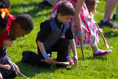 "Children roll Easter eggs at the White House Easter Egg Roll hosted by President Obama and Michelle Obama. The First Family hosted 30,000 people from all 50 states on the South Lawn of the White House for the 133rd White House Easter Egg Roll on April 25, 2011 in Washington DC. The theme of this year's egg roll is ""Get Up and Go,"" tied into first lady Michelle Obama's anti-obesity initiative to raise a healthier generation of kids."